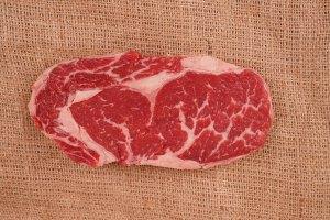 Raw fresh rib-eye steak