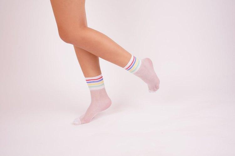 White socks on female legs stock image