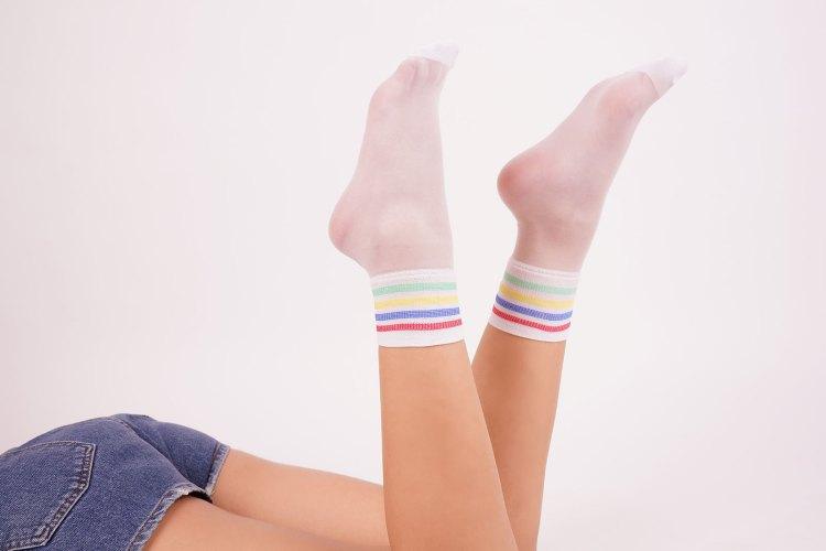 Young female wears stylish white socks