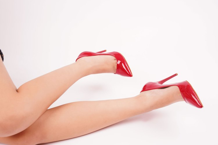 Woman legs in red high heel shoes indoor