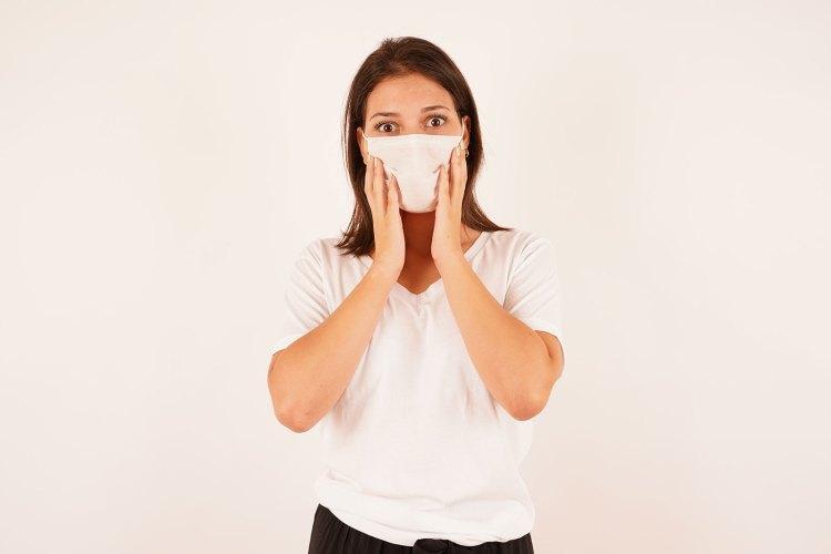 Portrait of shocked girl in mask