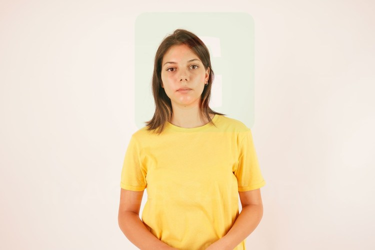 Attractive young girl in yellow