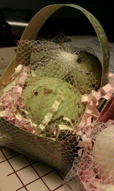A return of the little baskets of soap eggs for spring is in the works.  Baskets made of fun double sided card stock (scrapbook paper), and filled with two eggs the size of a large hens egg, made in our most popular varieties.... here pictured are gardener's soap.
