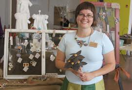 Nicole McGee with some of her creations... flowers, and jewelry.