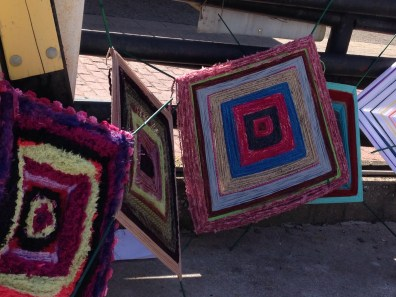 """The yarn bomb project - plan was to attach these """"eye of god"""" pieces to a chain link fence somewhere there in Akron."""