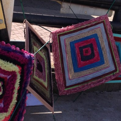 "The yarn bomb project - plan was to attach these ""eye of god"" pieces to a chain link fence somewhere there in Akron."