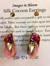 Small sterling hearts and czech glass pearls are stitched into the half cocoons, along with a small amount of alpaca roving dyed cotton candy pink.