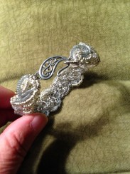 thin bracelet with silver glass seed beads, some sparkles, and a lovely silver hook clasp.