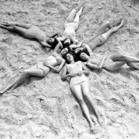 Six shapely lasses hit the beach at Coney Island, 1960