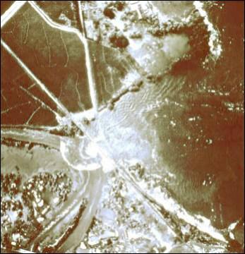 1952-Haleiwa-tsunami. 11-04-52-Aerial view of Kaika Bay near Haleiwa shows the 4th wave climbing up the beach (National Geophysical Data Center)