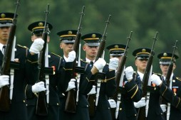 ARLINGTON, VA - JULY 13: A firing party fires a 21 gun salute during a funeral service for U.S. Army Maj. Paul Syverson at Arlington National Cemetary July 13, 2004 in Arlington, Virginia. Syverson was killed June 16 when he stopped to buy equipment at the PX at a U.S. base north of Baghdad. When CIA agent Johnny Mike Spann was killed in an Afghanistan prison uprising, Syverson was one of the special forces commandos sent in to retrieve his body and curtail the intense fighting. (Photo by Mark Wilson/Getty Images)