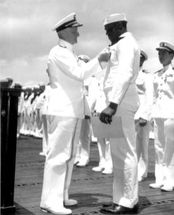 Admiral Chester Nimitz presenting the Navy Cross to Doris Miller