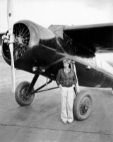 Amelia Earhart poses in front of her airplane in Wheeler Field, Hawaii, on January 4, 1935-NatlGeographic