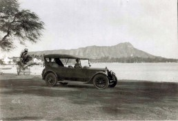Automobile with Diamond Head and Waikiki in background, 1933