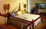 Coco Palms-Outrigger Bed with its Fishnet Bedspread, and Paddle Lights in the Wailua Kai Wing