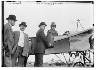Earle Ovington receives a bag of mail where he took off for the first official airmail flight in US