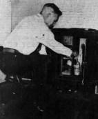 Eben Low pulling prized Okolehao from safe-SB-10-24-1938