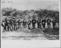 Firing Squad Company F of the National Guard of Hawaii, Kalalau Valley, Kauai. At grave of three members killed during hunt for Kaluaikoolau-HSA-HHS