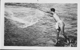 Fisherman in malo with throw net-UH-1940