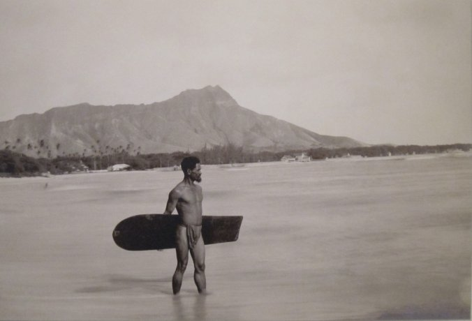 Hawaiian_with_surfboard_and_Diamond_Head_in_the_background-1890
