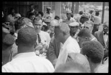 jackie-robinson-in-crowd-speaking-to-reporters-birmingham-ala-loc-1963