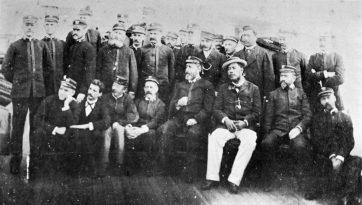 Kalakaua_aboard_the_U.S.S._Charleston-Colonel_George_W_Macfarlane_is_behind_the_King-(WC)-1890