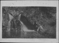 Kaluaikoolau seated on rock, his wife Piilani and son Kaleimanu in pool of Makemake Falls, Kalalau-HSA-HHS