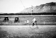 Kapiolani-Man riding a bike on the Kapi'olani race track-(waikikivisitor-com)