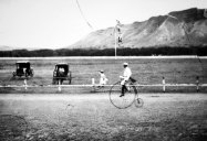 Kapiolani-Man riding a bike on the Kapi'olani race track-(waikikivisitor-com)