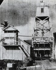 Lahaina-Harbor-Light-1866 lighthouse on the left and new 1905 skeleton tower (lighthouseguy-com)