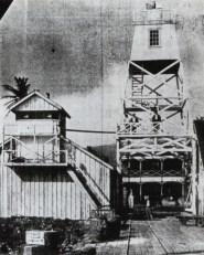 Lahaina-Harbor-Light-1866 lighthouse on the left and new 1905 skeleton tower (lighthouseguy-com)