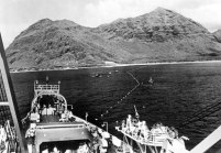 Laying the shore end of the first telephone cable to Japan in Makaha, Hawaii-(AT&T)-1964