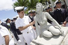 154044_1.tif. VESPUCCI SAILOR>>August 30, 2002/BRUCE APS/BRUCE ASATO PHOTOMarinaio Sergio Cadalano of the Italian Tall Ship Amerigo Vespucci touches a part of the Hula Dancer sculpture that was created by Italian Prisoner of War Alfredo Giusti in 1944 while interned at Sand Island. Cadalano is aboard the Amerigo Vespucci which sailed into Honolulu Harbor last week and will head to Tahiti and New Zealand after departing Honolulu.