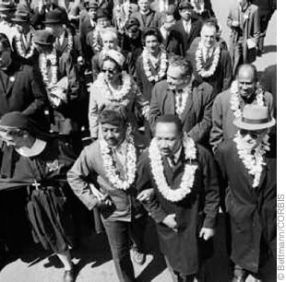 Martin Luther King and others wearing lei Selma to Montgomery on March 22, 1965