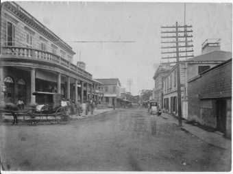 Merchant street looking toward Waikiki. Kamehameha V Post Office in left foreground, right rear Bishop Bank-1885
