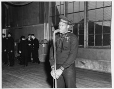Miller speaking during a visit to the Naval Training Station, Great Lakes, Illinois, on 7 January 1943-80-G-294808