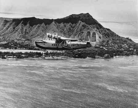 Pan American Clipper flying over Waikiki with Diamond Head in background-PP-1-8-013-1935