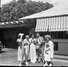 People standing in front of the Hind-Clarke Dairy Ice Cream Stand, Aina Haina Valley-(gsu-edu)-1930s