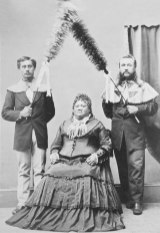 Princess Ruth Keelikolani with hapa-haole chiefs Samuel Parker and John Adams Cummins as kāhili bearers