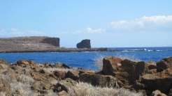 Puʻupehe Islet (also known as Sweetheart Rock) viewed from Kapihaʻā village shoreline, Lānaʻi