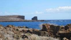 Puʻupehe Islet (also known as Sweetheart Rock) viewed from Kapihaʻā village shoreline, Lānaʻi