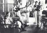Amelia Earhart & husband George Putnam are serenaded by Royal Hawaiian Hotel musicians 1-2-1935