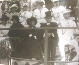 Queen Liliuokalani seated in the front row-ceremony of 1st major ship to enter Pearl Harbor-1911
