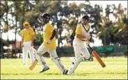 Raghu Srinivasan, left, and James Le Marchant Lawrence of the Spitting Cobras, pass each other en route to scoring a run-(honolulucricketclub-org)