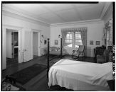 UPSTAIRS BEDROOM, SOUTHEAST CORNER, LOOKING NORTHEAST, ROOF OF LAUNDRY HOUSE CAN BE SEEN OUT WINDOW-LOC