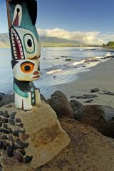 Sunrise at Mai Poina Oe Iau Beach (Forget Me Not Beach) in Kihei across from the Maui Lu, where totem poles brought from Vancouver Island mark the area of Captain George Vancouver's mooring when he visited Maui in three sucessive years (1792-94). Kihei, Maui, Hawaii