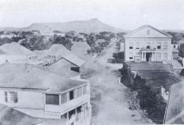 View of Queen Street, Honolulu in 1857, left, Hudson's Bay store-right work begun on the demolition of 1816 fort wall-1857