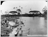 Waiakea River with fishing canoes and people gathered on shore-PP-29-4-014