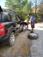 our driver and guide changing a wheel, the roads are challenging