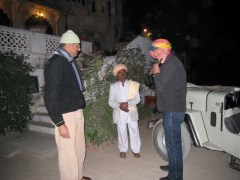 trying a flute, note the turban
